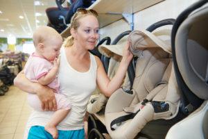 woman choosing child car seat at the target trade in car seat 2020